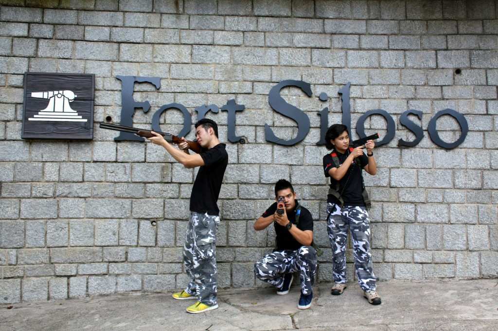 Staff posing with guns