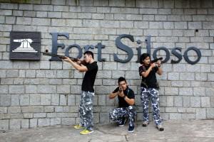 Staff posing with guns